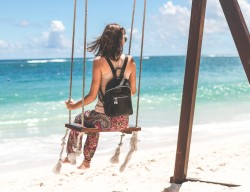 negative-space-woman-beach-swing-blue-sky-sand-sea-artem-bali